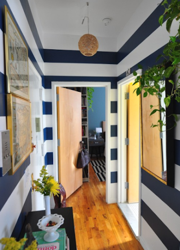 wide blue and white wall stripes in hallway