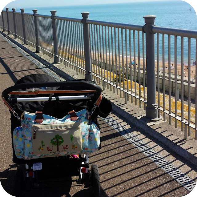 stroll on seafront, pink lining bag, double buggy at the seaside