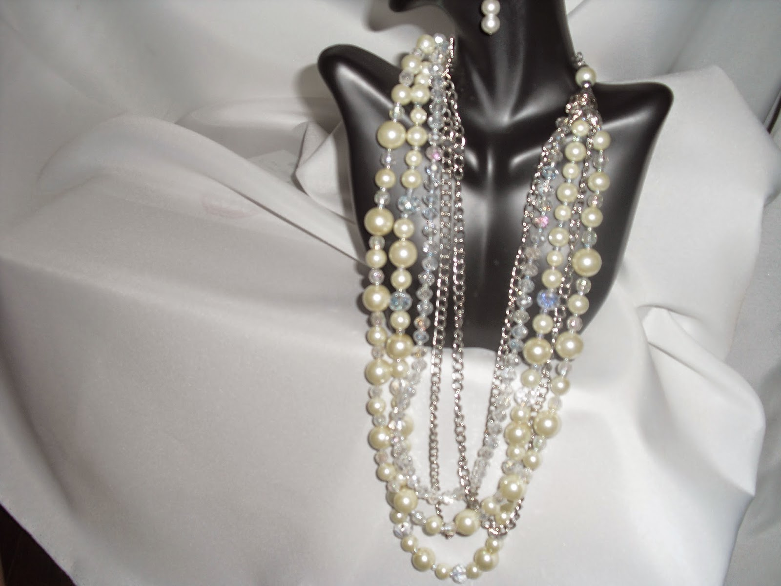 Layer Multiple Strands Of Pearl Necklace According To The Sizes And  Lengths Pearlse In Various Colours Even Though White Is The Most  Popular