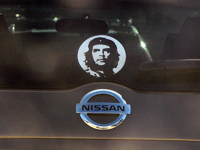 a late model Nissan van with the Korda Che Guevara image on the back window