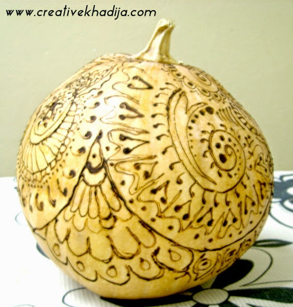 http://creativekhadija.com/2014/09/halloween-pumpkin-with-henna/