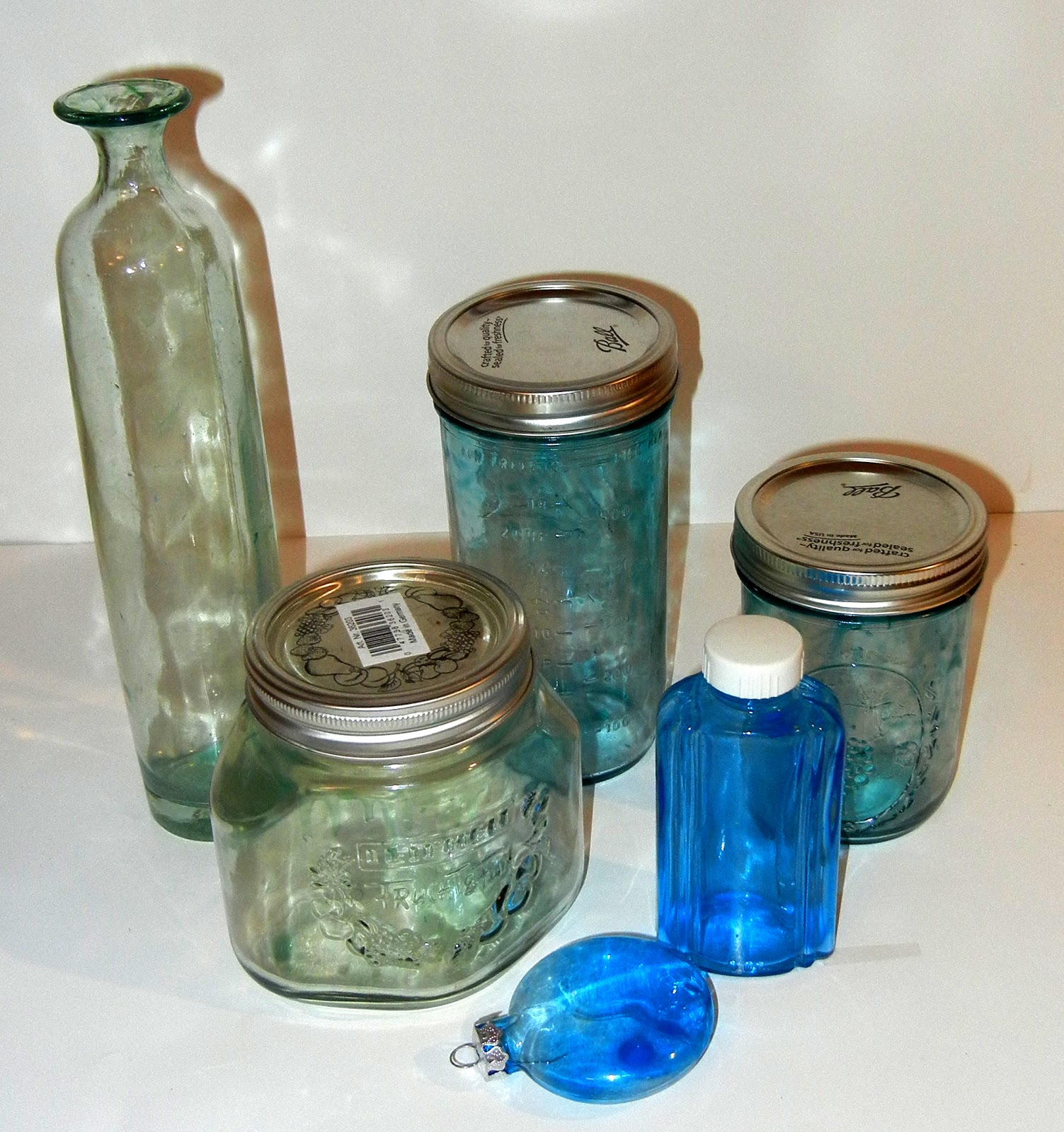 Photo display ideas color tinting glass bottles and jars for Glass bottle display ideas