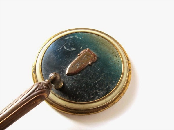 https://www.etsy.com/listing/188766644/vintage-hand-mirror-with-adjustable?ref=shop_home_active_2