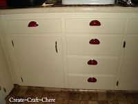 Retro red hardware drawer pulls make the cabinets pop