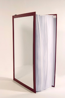 "he mirror-book ""Reflexions"" can also be hanged on the wall"