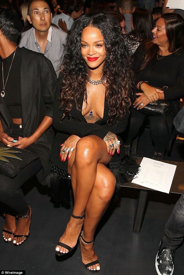 Rihanna wears a fringed jacket and bikini bottoms to the Altuzarra New York Fashion Week Show