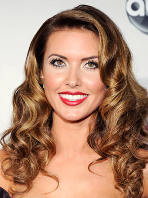Audrina Patridge adds oomph to Audrina Patridge curly hairstyles mane with lots of volume.