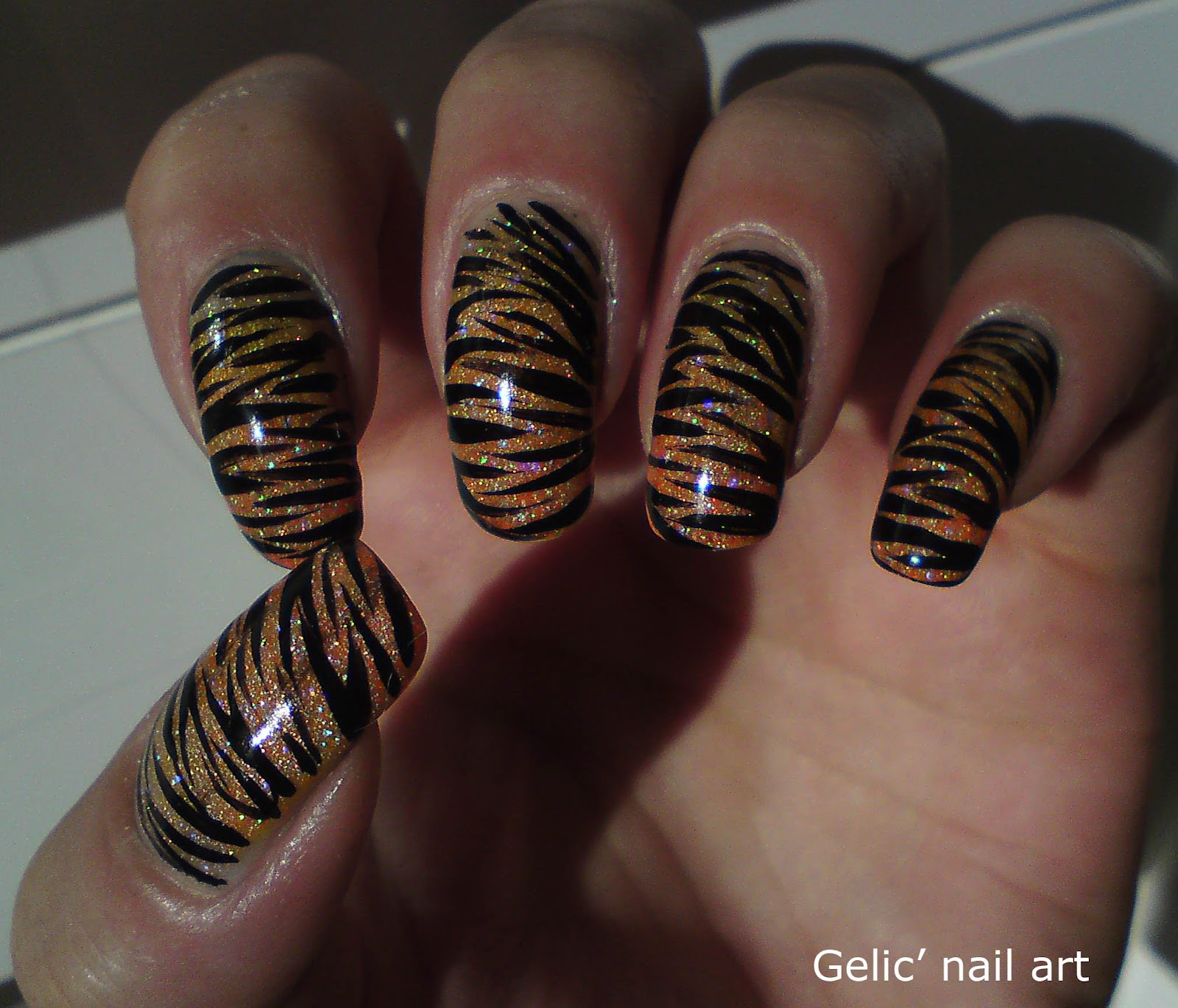 Gelic Nail Art Tiger Nail Art On Orange Neon Holo Gradient
