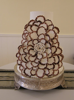 3-tier (extra deep) round buttercream with fondant flower