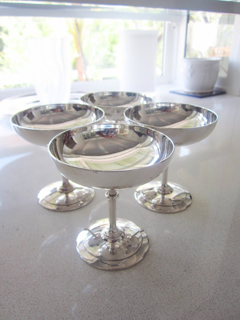 four silver champagne coupes