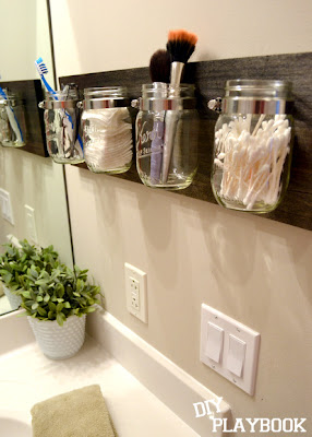Mason Jars on wood to organize bathroom clutter