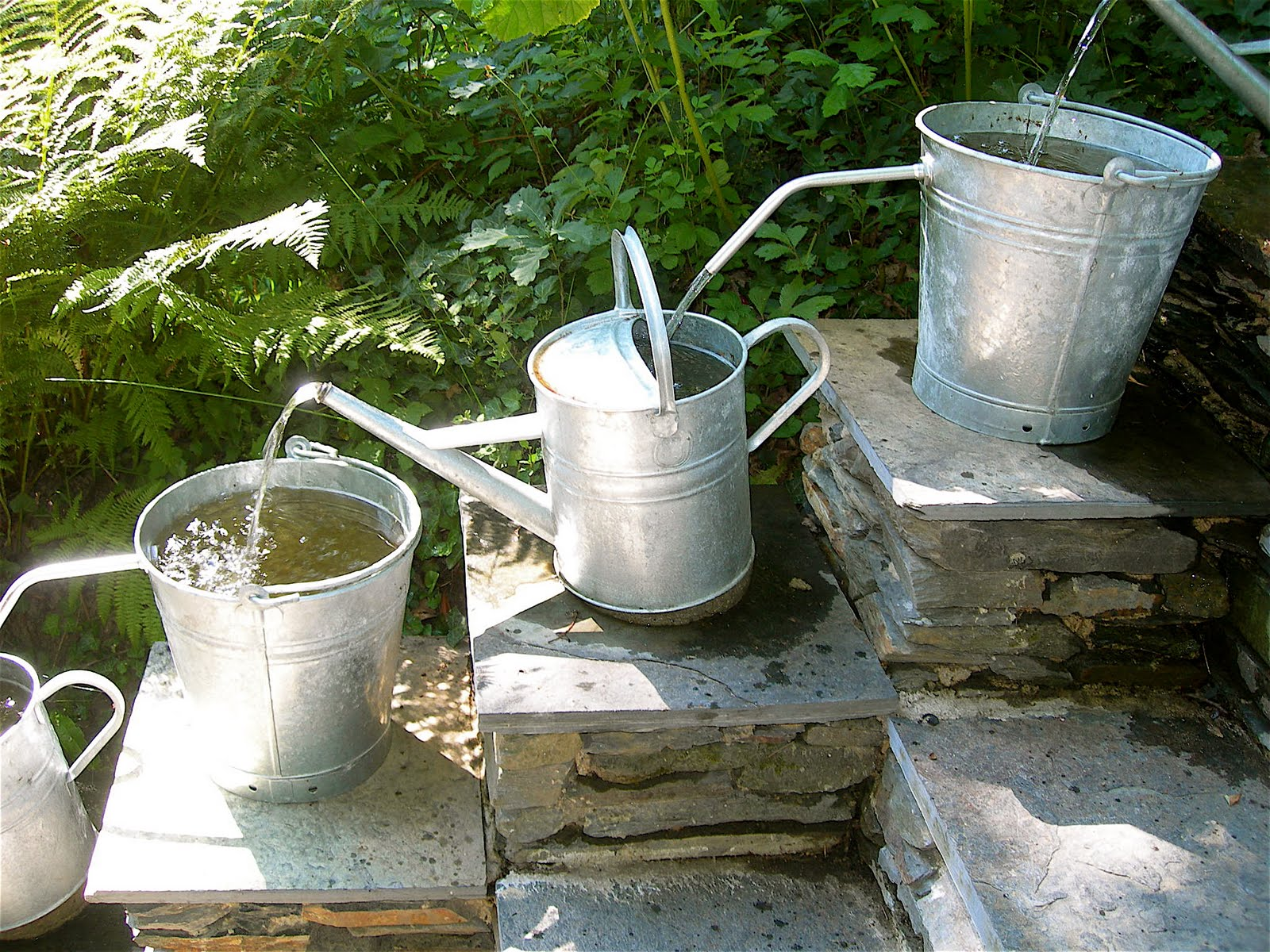 Pilgrim and pie in france water feature with watering cans for Water features