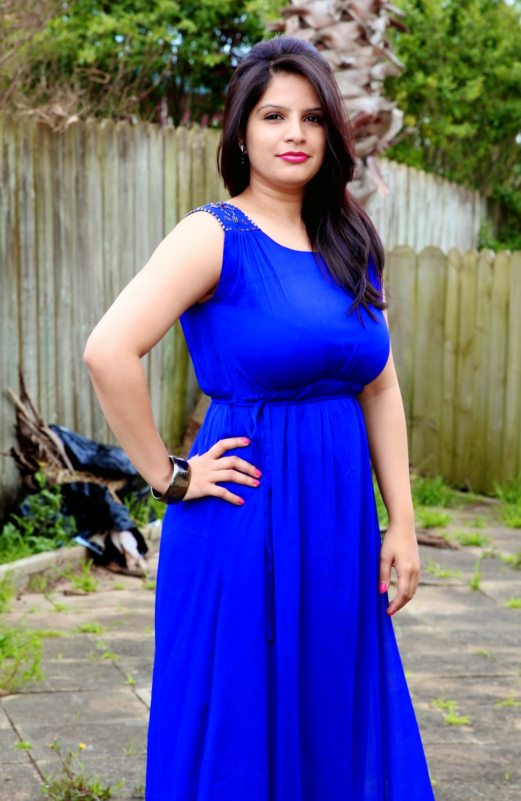 Indian lady in a blue gown, gowns for plus size women, decent looking gowns, all purpose gowns, simple elegant gown