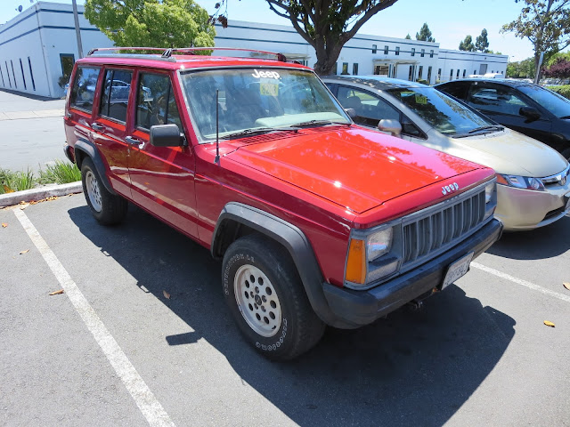 Shiny paint after rust repairs on Jeep Cherokee at Almost Everything Auto Body