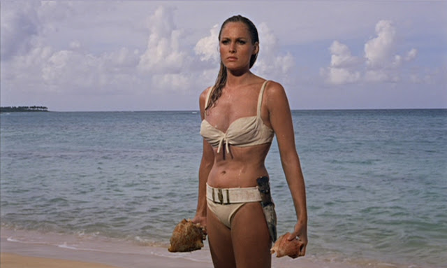 Ursulla Andress as Honey Ryder in her iconic white bikini, Honey Rider