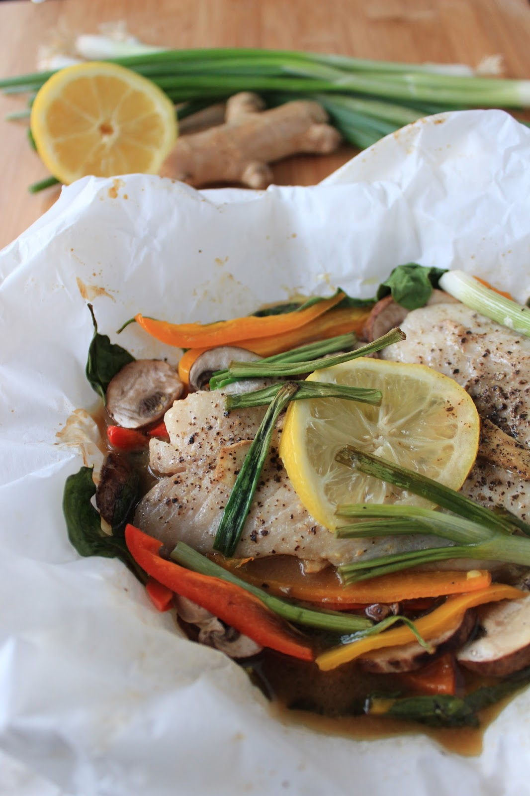 fish cooked in parchment paper That looks so appetizing and easy never thought about cooking in parchment paper myself, though i've seen it in restaurants i'll have to try it.