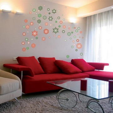 [A living room with a wall which is decorated with snowflakes]