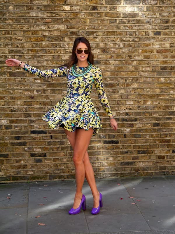 Spinning in a H&M floral dress and Christian Dior purple heels on a sunny day in Mayfair