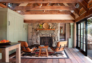 Wonderful Lounge Chairs facing the Stone Rustic Fireplace Mantels under Small Lamps and the Wooden Ceiling