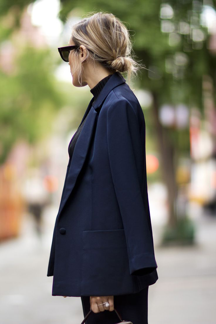 Street style, messy hair, low bun, navy structured blazer, effortless chic