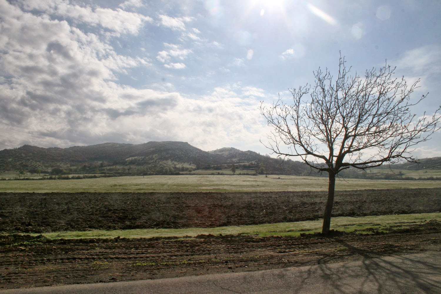 Leaving town, ploughed fields and mountains