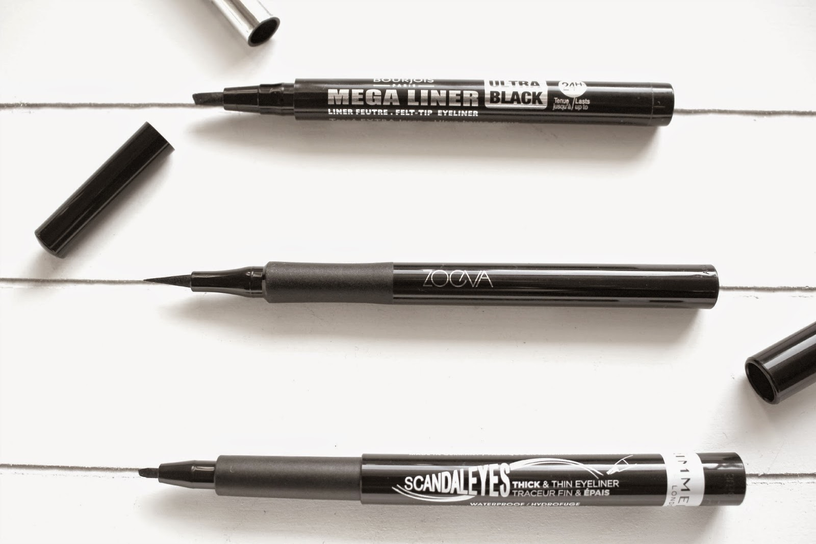 It's a loose connection, I know but I've been really loving three in particular black eyeliner pens recently so what better day to blog about them than ...