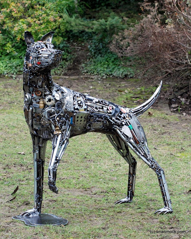 The art of up cycling garden sculpture metal garden art for Dog wire art