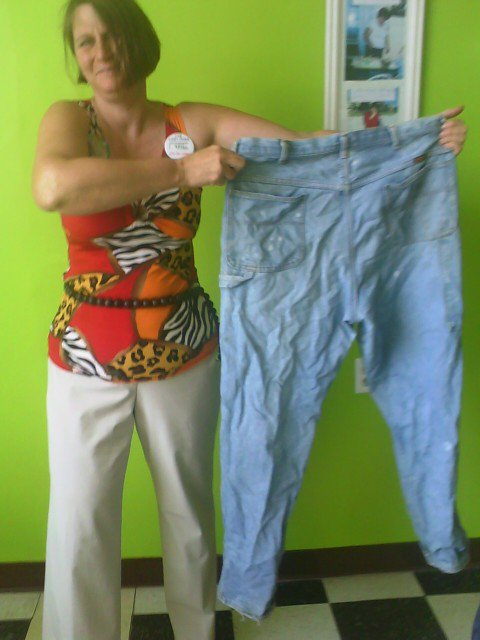 Me after my 100 lb weightloss with my big pants!