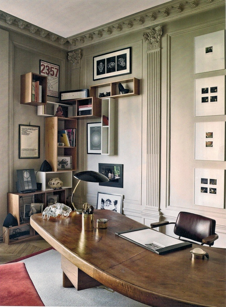 Stefano Pilati´s office in Paris: Charlotte Perriand´s massive wood desk and Jean Prouvé´s office chair, both ca.1950s. Photograph by James Mollison