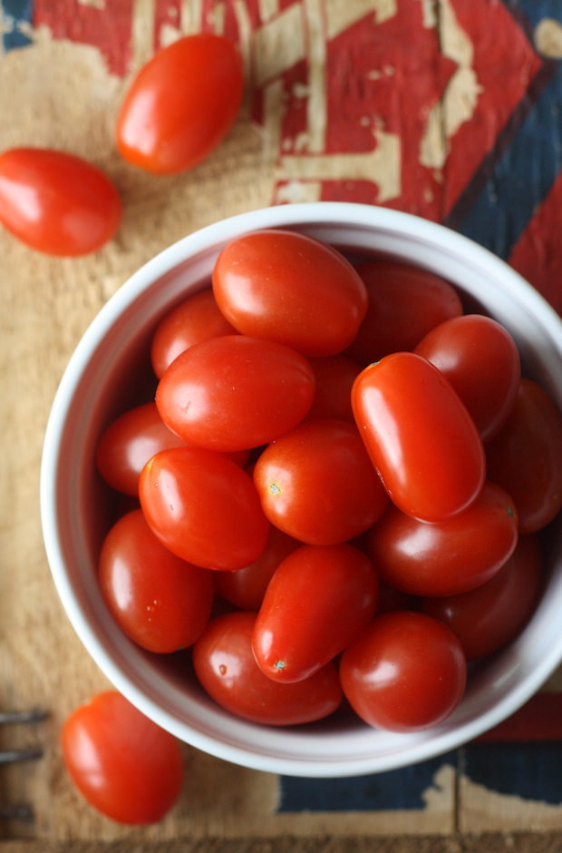 cherry tomatoes in white bowl