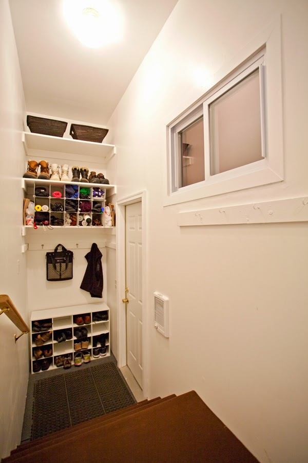 mudroom with shelves and heater