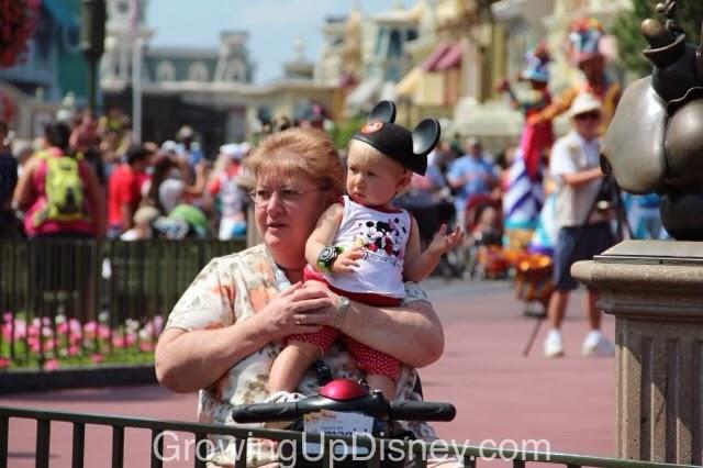 baby enjoying Disney parade