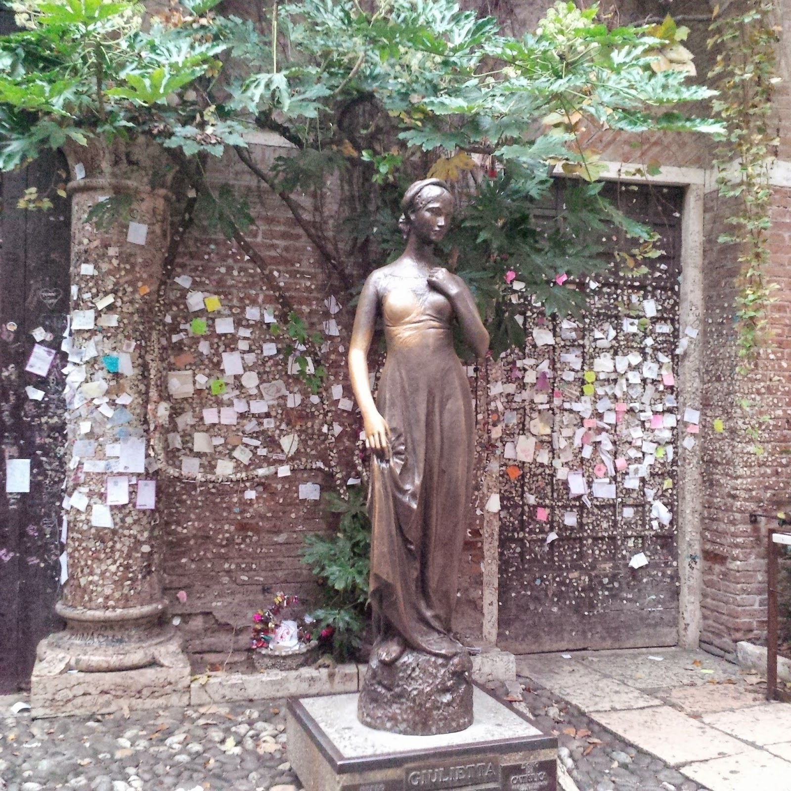 The statue of Juliet in front of her house in Verona