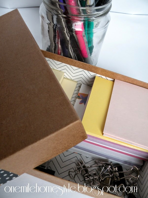 Notepads and post-its in a decorative box
