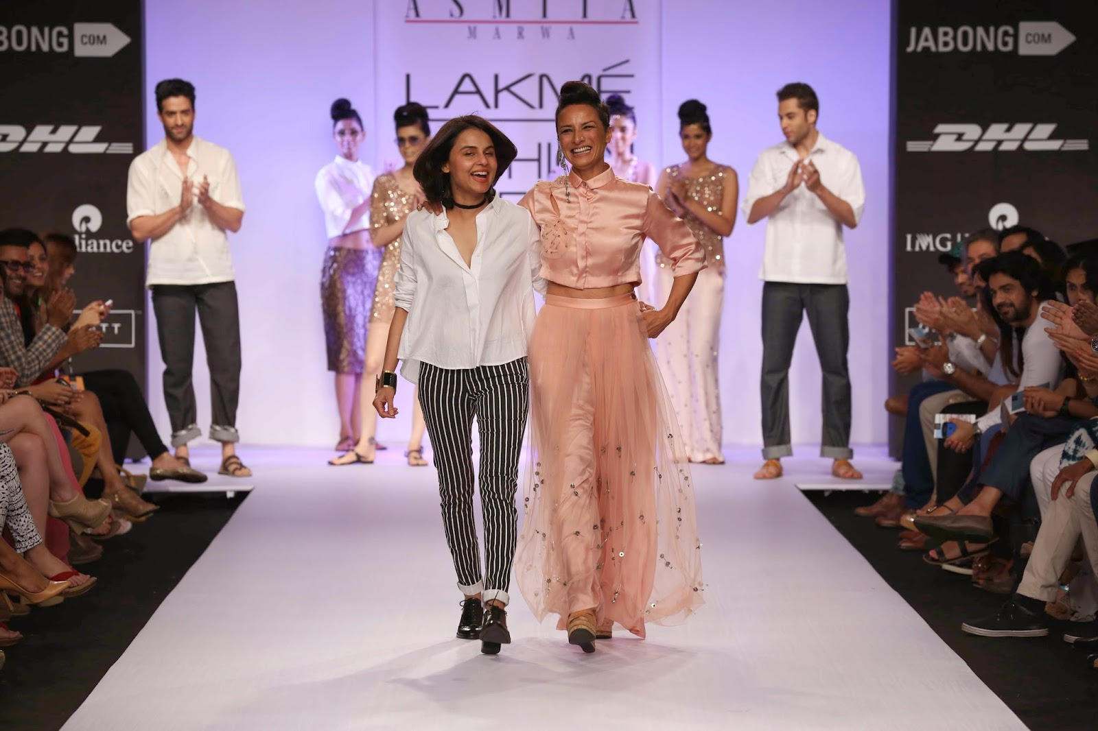 Asmita's choice of showstopper was the India's top hairstylist, the very perky and effervescent Adhuna Akhtar who jauntily walked down the ramp in salmon pink net palazzo with pin detailing and satin silk cropped shirt.
