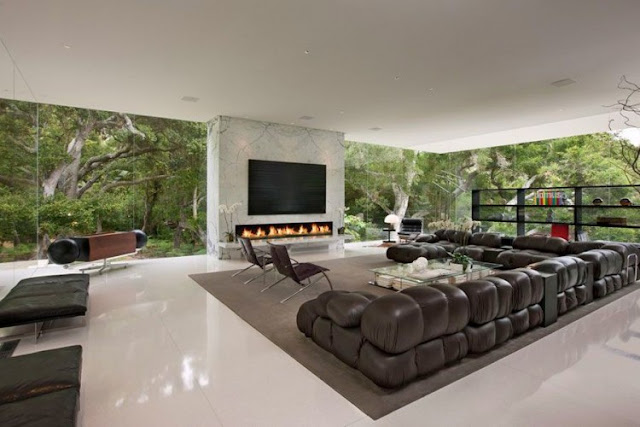 Photo of modern minimalist living room with glass walls