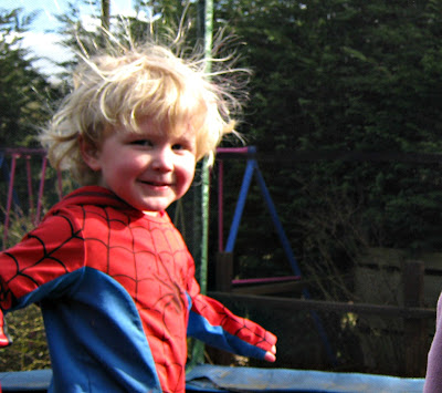 Child long blond messy hair on trampoline