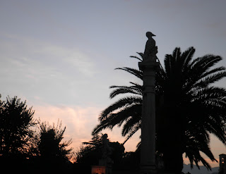 Sunset behind the woodpecker symbol of Ascoli Piceno
