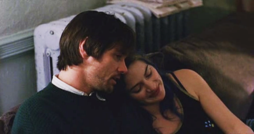 Scene of Eternal Sunshine of the Spotless Mind with Kate Winslet leaning on Jim Carrey's shoulder