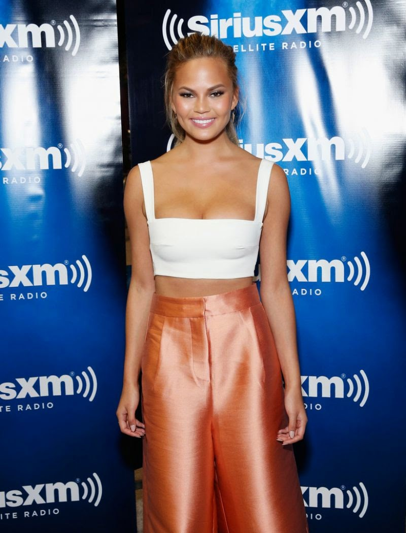 Chrissy Teigen flaunts cleavage at the SiriusXM Super Bowl XLIX Radio Row in Phoenix