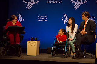 "Photo of Judy Heumann and panelists discussing ""empowering the world's billion people with disabilities"" at the 2013 Clinton Global Initiative."