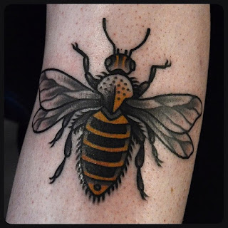 black and white and gold bee tattoo
