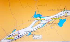 We're the little green boat, The tows are coming from each end.  Photo of our chart plotter.