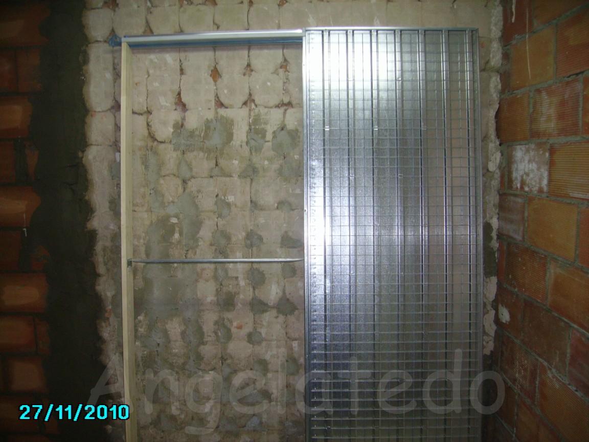 Instalar puerta corredera empotrada en obra angelatedo for Colocar puerta corredera