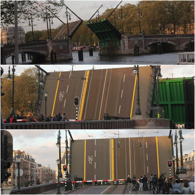 A Street Bridge Opening to give way for big cruises to pass by in Amsterdam, Netherlands
