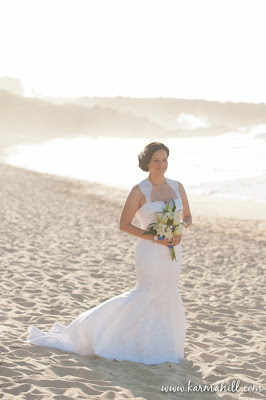 Beautiful bride walking down the beach at DT Flemming Beach