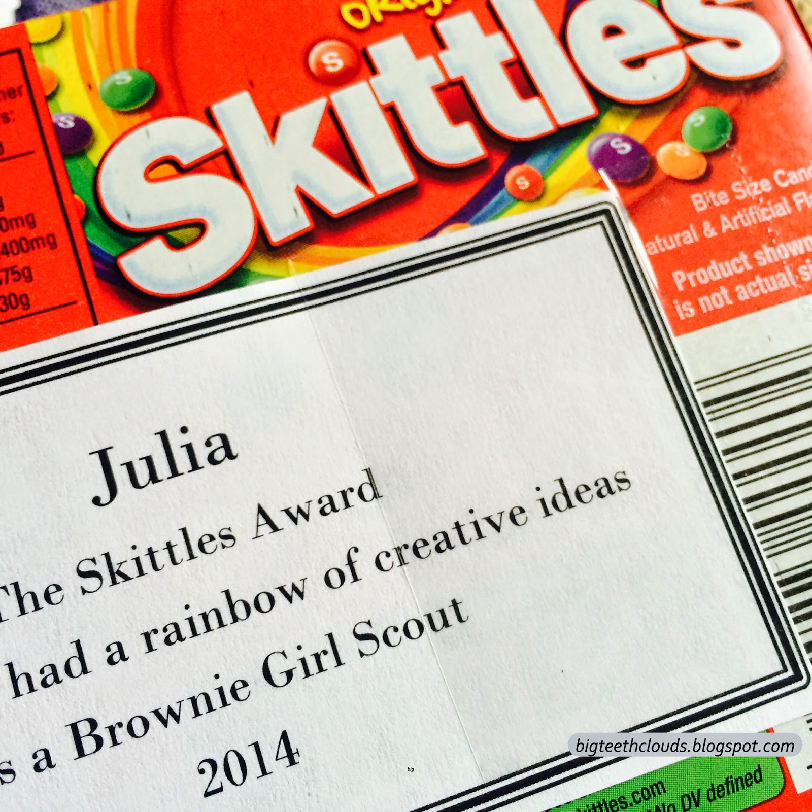 A finished candy award with the identifying slip of paper taped in place.
