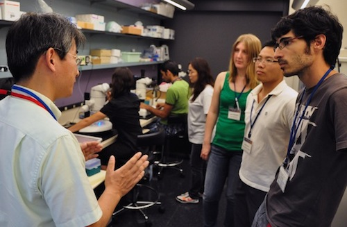 Laura in the zebrafish lab with Dr. Ichiro Masai and DNC 2011 students