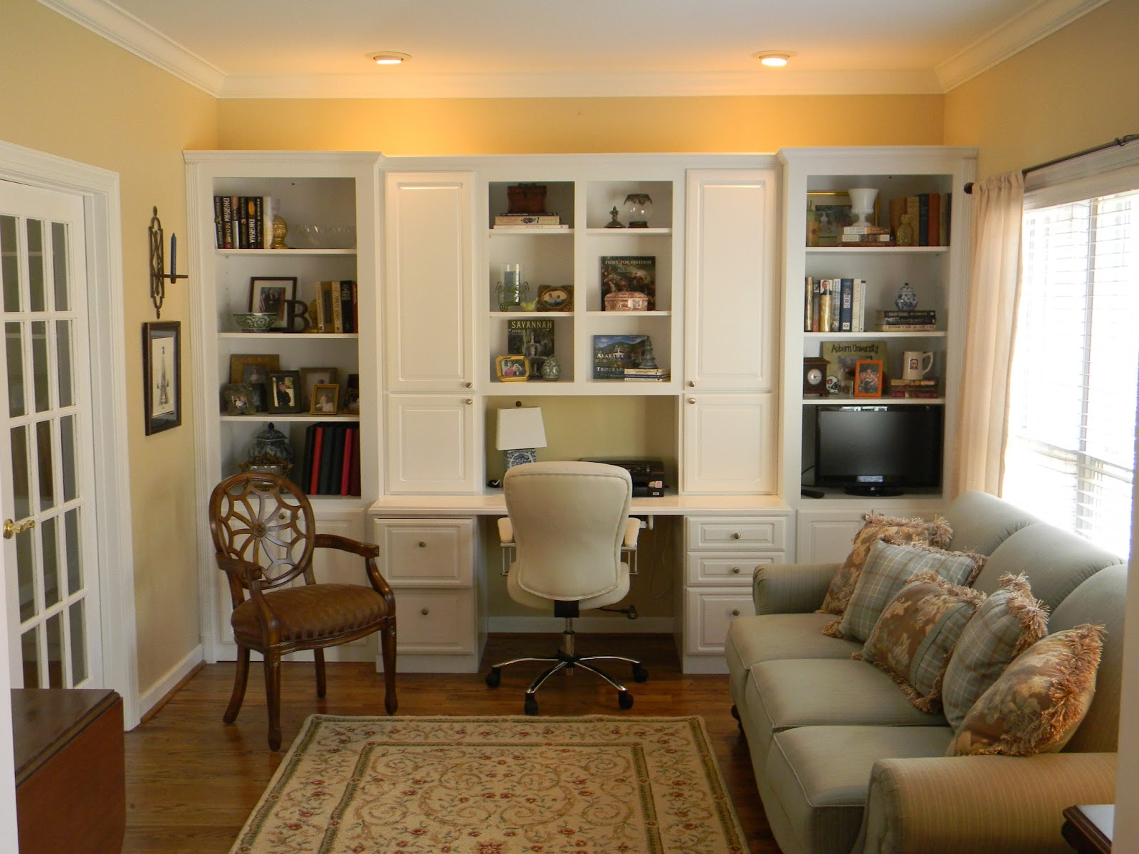 positively southern living room office with built in cabinets