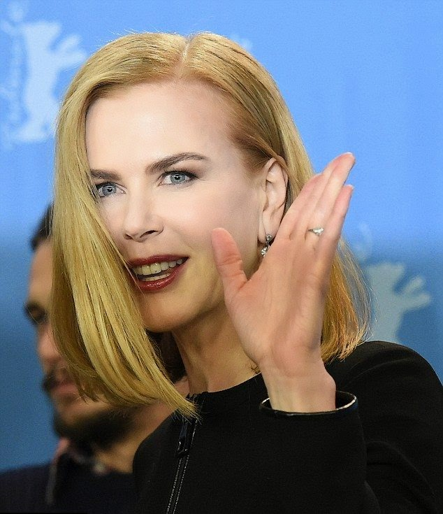 The 47-year-old looked simply fabulous from every vantage point as she wore a dark short dress to the premiere of her latest film, Queen Of The Desert on same day in the daylight appearance at the Berlin Film Festival.